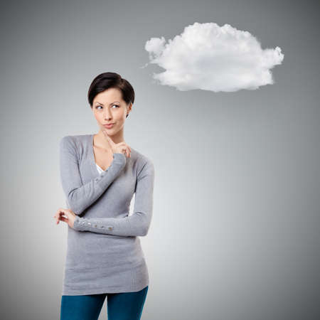 intriguing: Intriguing look with cloud, gey background Stock Photo