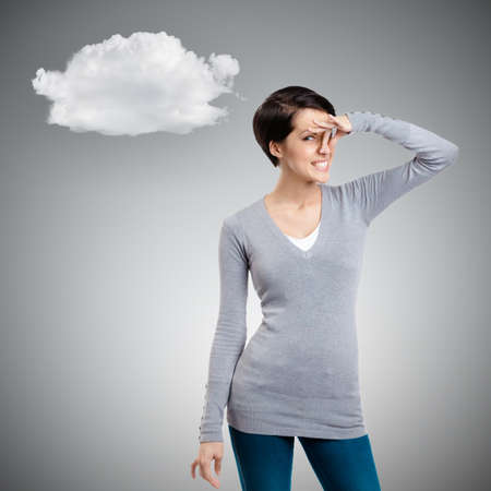 Young woman closes her nose with fingers, isolated on grey background with cloud photo