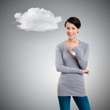 mystique: Pointing finger gesture, isolated on grey background with cloud Stock Photo
