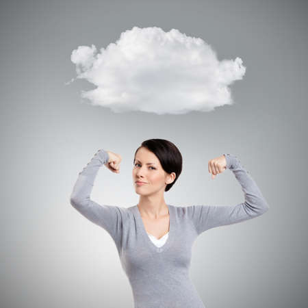 admires: Beautiful woman admires her own strength, isolated on grey Stock Photo