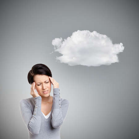 put pressure: Girl has a headache, grey background with cloud