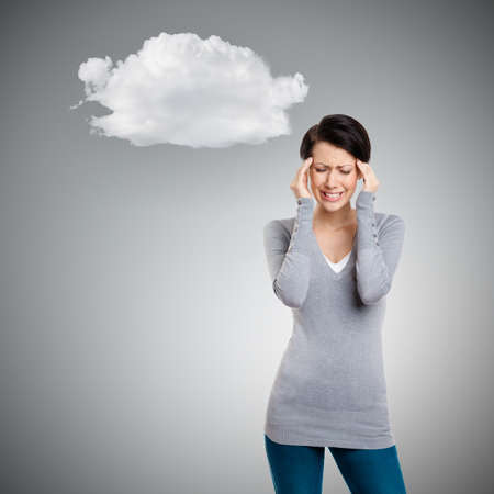 Girl is in despair trying to solve problems, isolated on grey background