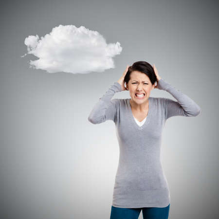 unkind: Woman is in panic, grey background with cloud
