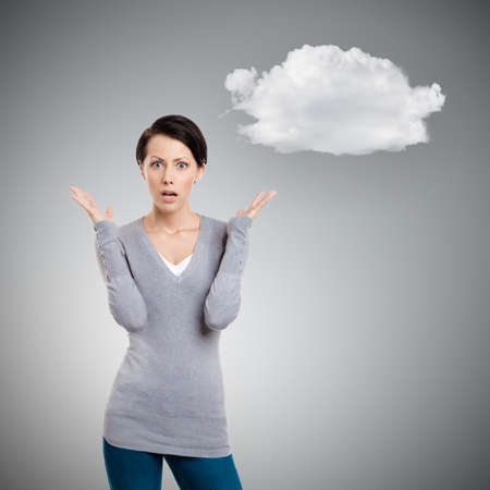 put pressure: Puzzled woman, isolated on grey background with cloud