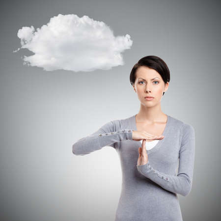hands out: Serious girl gestures timeout, isolated on grey background