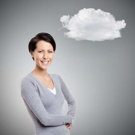 Smiley young woman with cloud, on grey background photo