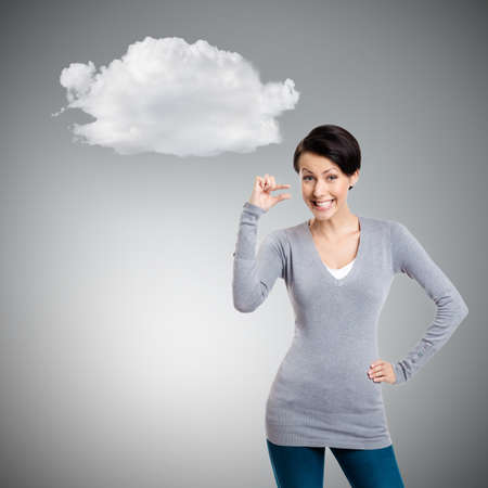 Attractive woman gestures small amount, isolated on grey background with cloud photo