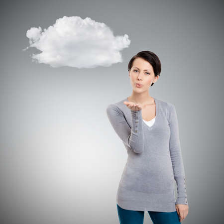 throws: Beautiful woman throws a kiss, grey background with cloud