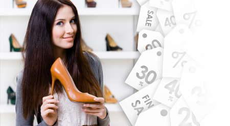 high heeled: Pretty woman keeping brown leather high heeled shoe on clearance sale in shopping center