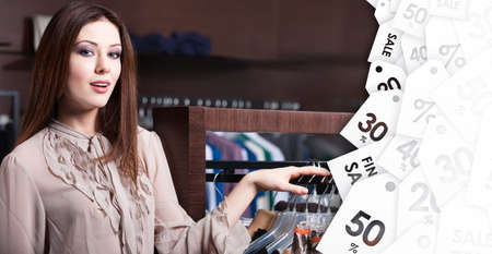 color range: Attractive woman is in the store with wide range of clothes on sale