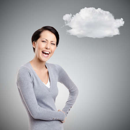 Laughing woman with two hands on the hips with cloud, on grey background photo