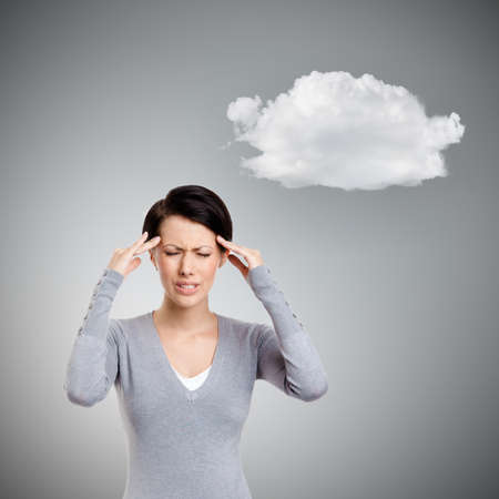 put pressure: Upset girl tries to solve problems, isolated on grey background with cloud