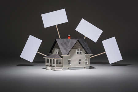 architectural model: Realty concept - house architectural model on grey background
