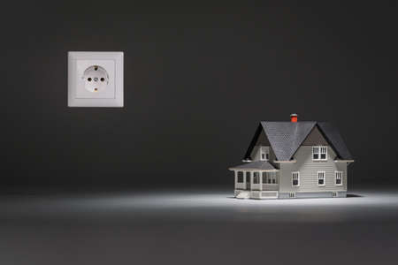 architectural model: Home architectural model with socket on grey background