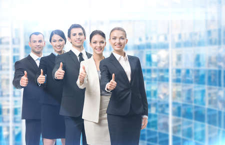 teamwork business: Thumbing up group of business people, blue background. Concept of teamwork and cooperation