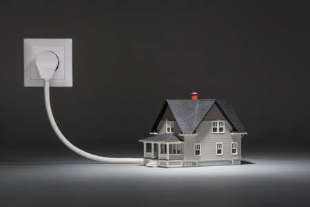 realty residence: House architectural model connected to electricity