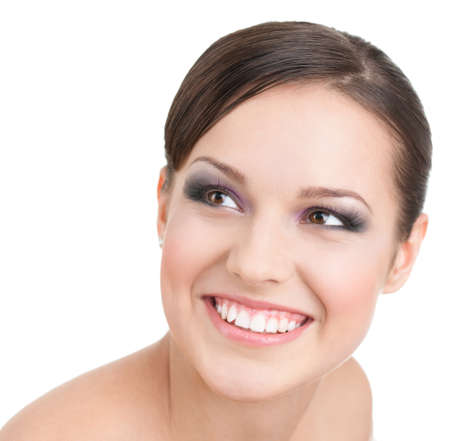 Portrait of smiling beautiful  woman with makeup, isolated on white Standard-Bild