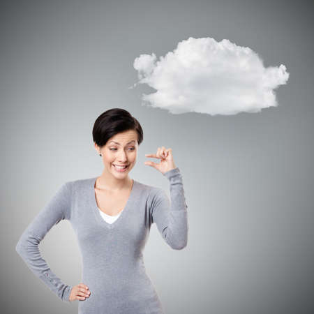 mocking: Mocking woman gestures small amount, isolated on grey background with cloud