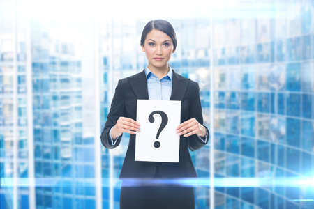 Portrait of businesswoman with question mark, modern background. Concept of problem and solution