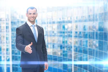 Portrait of business man handshake gesturing, blue background. Concept of leadership and success Standard-Bild