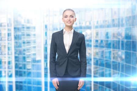 Half-length portrait of smiley businesswoman, blue background. Concept of leadership and success Standard-Bild
