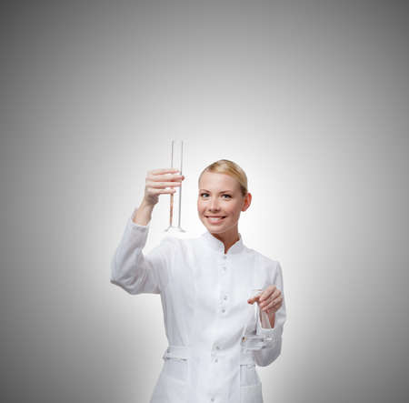 Pretty doctor hands graduated cylinder and Erlenmeyer flask, isolated on white Standard-Bild