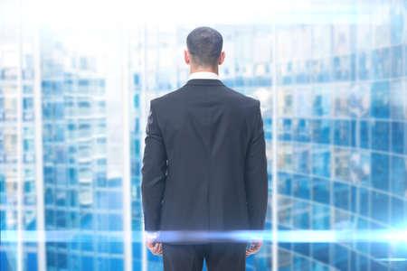 Backview of businessman, blue background