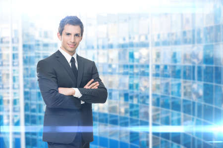 Portrait of business man with crossed hands, blue background. Concept of leadership and success Standard-Bild