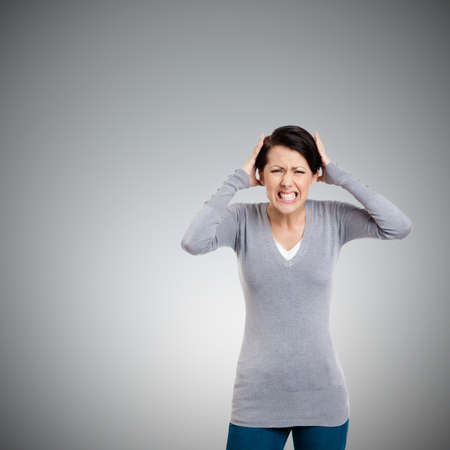 Woman is in panic, isolated on grey