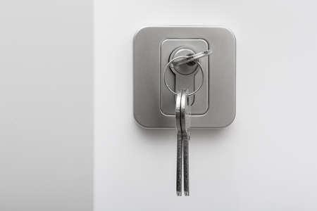 Set of keys in the keyhole on white background