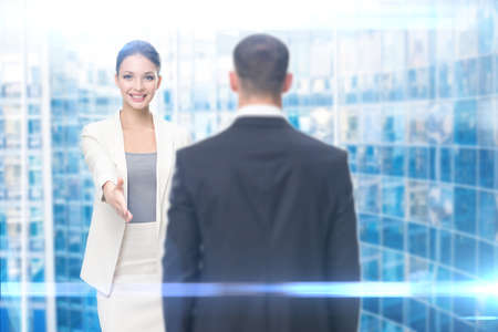 Portrait of businesswoman handshake gesturing with business man, on blue background. Concept of leadership and success