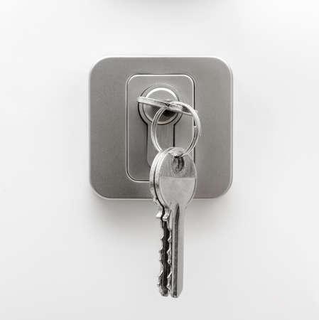 House keys on door lock - white background