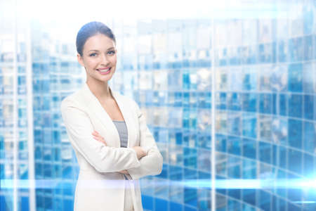 Portrait of business woman with hands crossed, modern blue background. Concept of leadership and success