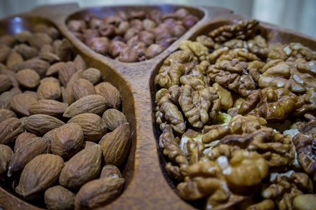 good cholesterol: Almonds, nuts and hezelnuts in wooden bowl