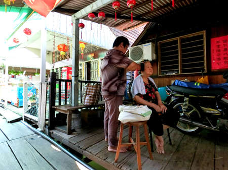 chew: Life style of the elderly in Chew Jetty, Penang Editorial