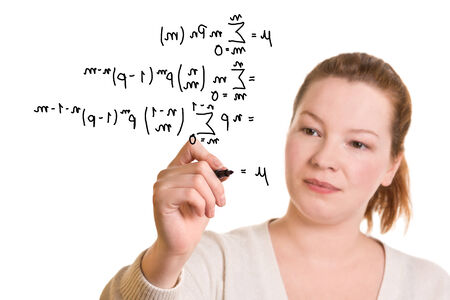 Young woman writing mathematical formula with a pen photo