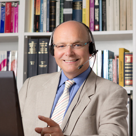 Experienced employee of customer service with headphones smiling happily photo