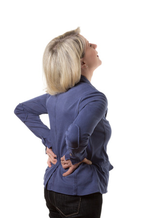 Blond woman with violent back pain, isolated, copyspace