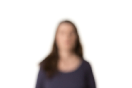 Head and shoulders of long-haired woman blurred in front of white, horizontal Archivio Fotografico