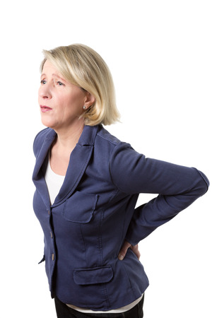 Middle aged woman with violent pain because of a lumbago, isolated on white