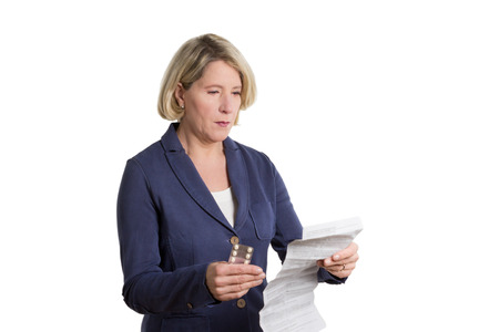 Senior woman reading package insert of her new medication, copy space, isolated