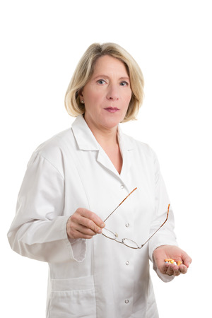 copyspace: Blond Doctor with different tablets looking skeptical, isolated on white, copyspace Stock Photo