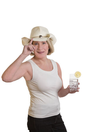 Blond woman in summer with Stetson and longdrink glass, isolated, copy space photo
