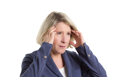 fibromyalgia: Woman pressing her fingers on her temples because of a headache or migraine, copy space, isolated