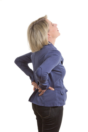 pulled: Woman with low back pain because of a pulled muscle, isolated, copy space Stock Photo