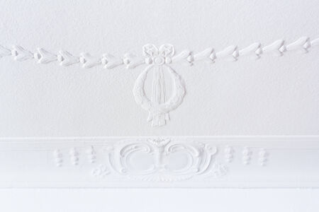 White plastering on the ceiling of an old house, wreath and flowers, wilhelminian style Stock Photo - 29181603