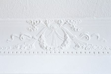 White stucco between ceiling and wall, wreath, flowers and ribbon, art nouveau, copy space Stock Photo - 29181605