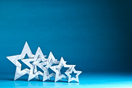 rating: Five shiny silver stars on blue and turquoise  background, copy space Stock Photo