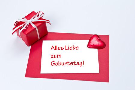 in liebe: Gift box with card and heart, text, german, alles liebe zum geburtstag