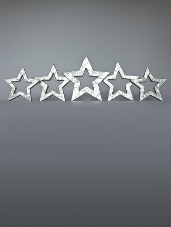 silver stars: Five silver stars on gray background low angle view copyspace